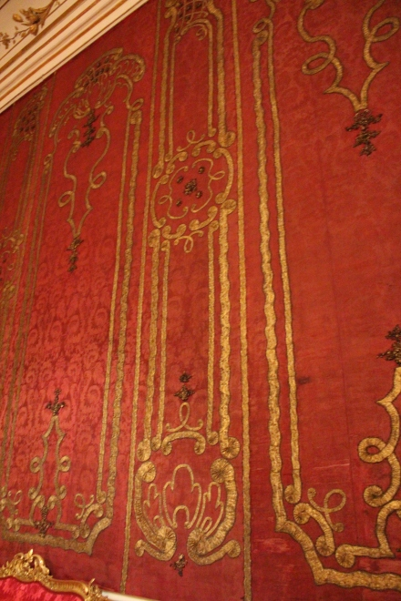 The original silk wall covering had seen better days, but the luxury was not lost.