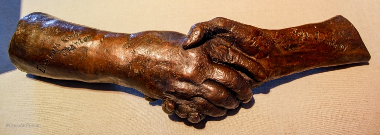 A cast made later in life of Elizabeth Cady Stanton and Susan B. Anthony shaking hands